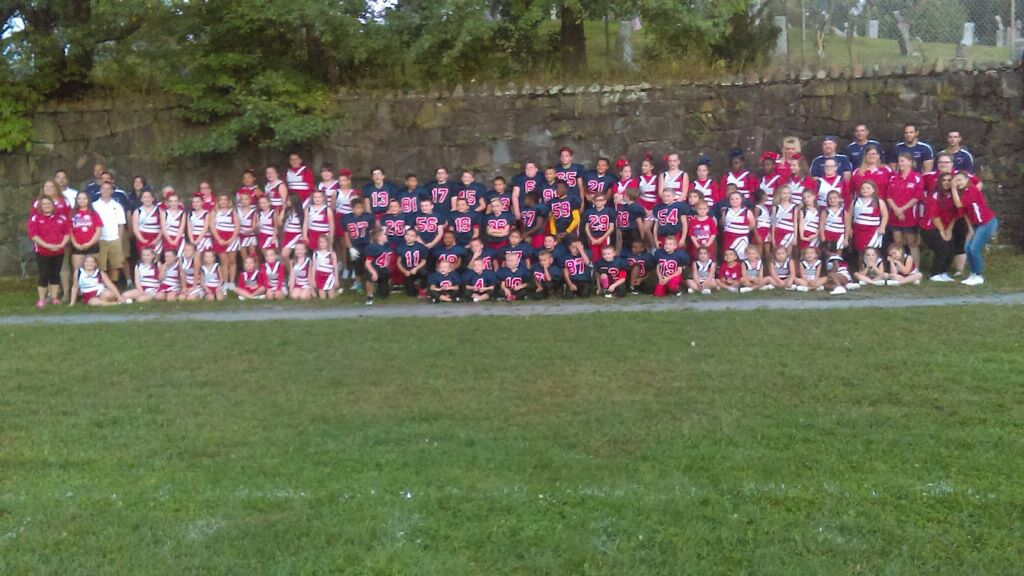group photo showing the mini-football and cheer teams